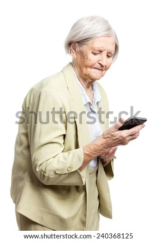 Senior woman using mobile phone - stock photo