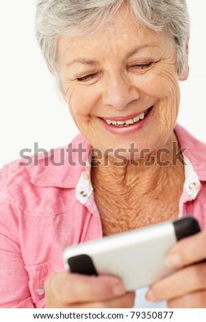 Senior woman using mobile phone - stock photo