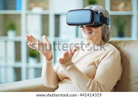 Senior woman using vr glasses