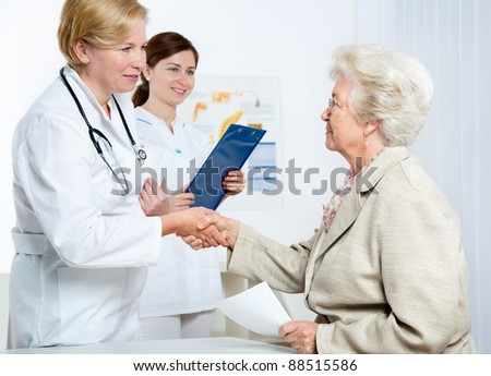 senior woman visiting a doctor - stock photo