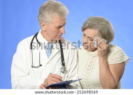 Senior woman visiting doctor - stock photo