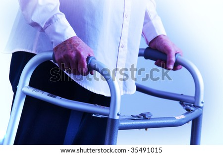 senior woman walking on walker - stock photo