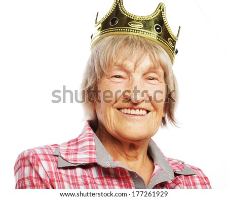 Senior woman wearing crown doing funky action isolated on white background  - stock photo