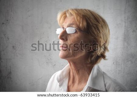 Senior woman wearing glasses - stock photo