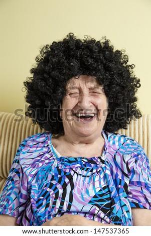 senior woman wearing wig - stock photo