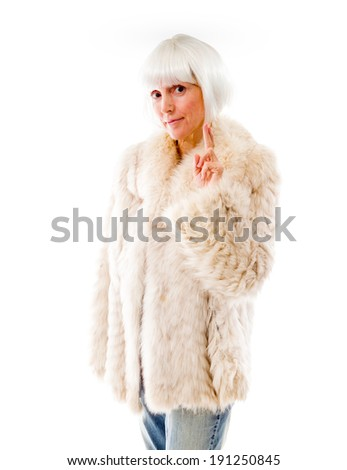 Senior woman wishing with crossing fingers - stock photo