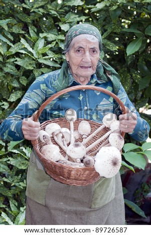 senior woman with a basket full of mushrooms