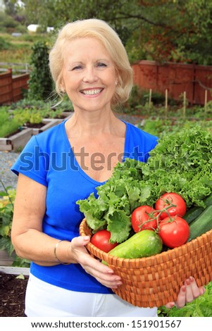 Senior woman with a basket of fresh vegetables. Also available in horizontal.