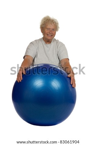 Senior woman with a fitball on white background - stock photo