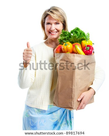 Senior woman with a grocery shopping bag. Isolated on white background. - stock photo