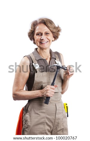Senior woman with a hammer (white background)