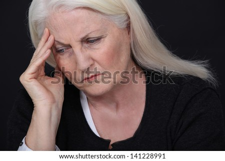 Senior woman with a headache
