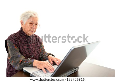 Senior woman with a notebook - stock photo