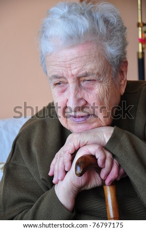 senior woman with a wooden cane - stock photo