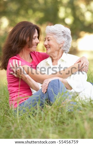 Senior Woman With Adult Daughter In Park
