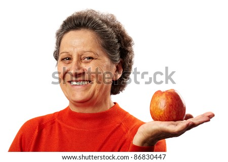 Senior woman with apple, healthy eating concept - stock photo
