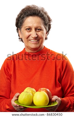 Senior woman with apples on a plate, healthy eating concept - stock photo