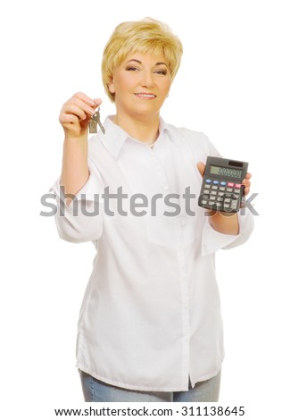 Senior woman with calculator and keys isolated - stock photo