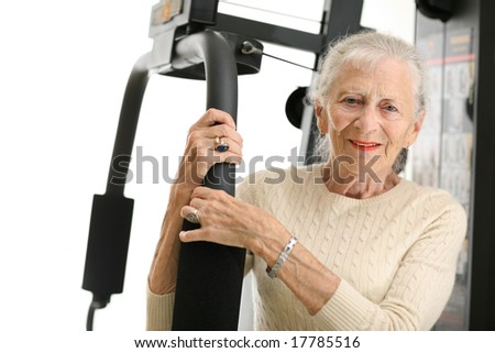 Senior woman with fitness machine over white background - stock photo