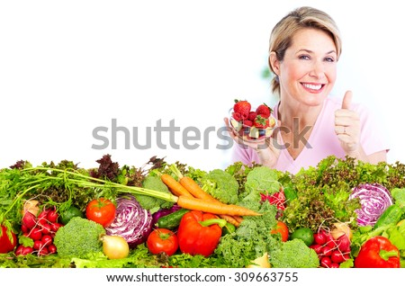 Senior woman with fresh vegetables and fruits. Healthy diet. - stock photo