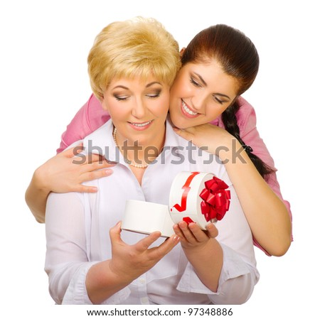 Senior woman with gift isolated - stock photo