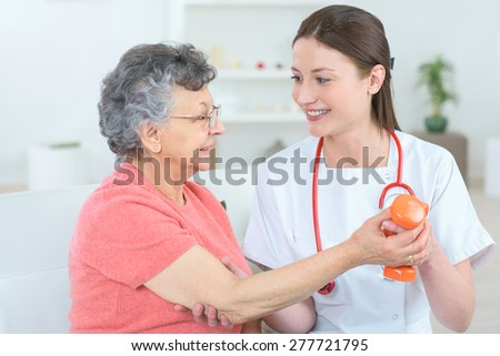 Senior woman with hand weights