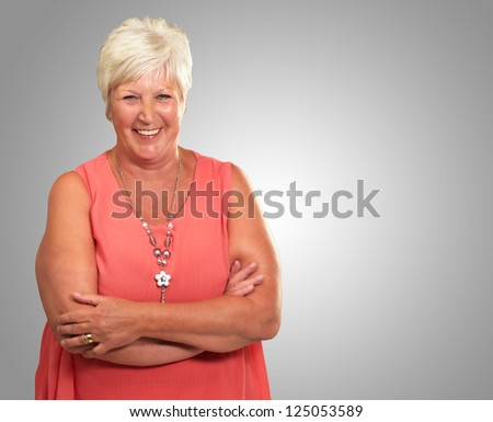 Senior Woman With Hands Crossed Isolated On gray Background - stock photo