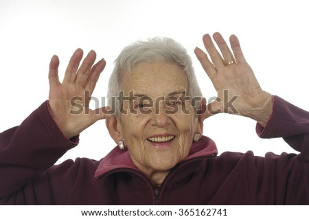 senior woman with hands on ears, mocking - stock photo