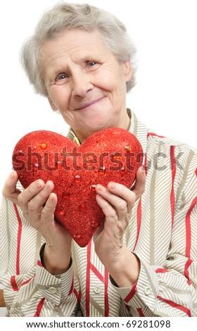 senior woman with heart. over white - stock photo