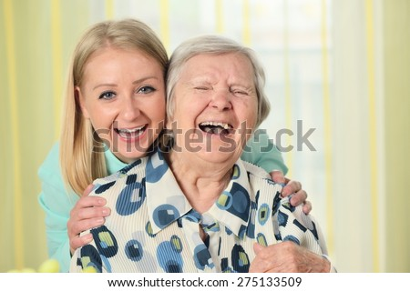 Senior woman with her caregiver. Happy and smiling. MANY OTHER PHOTOS FROM THIS SERIES IN MY PORTFOLIO. - stock photo