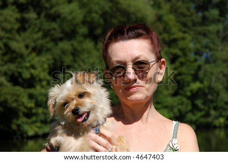 Senior woman with her dog - stock photo