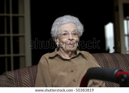Senior woman with her walker at an assisted living facility - stock photo