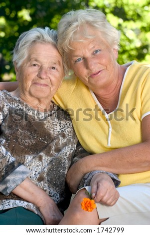 Senior woman with her 60 year old daughter.