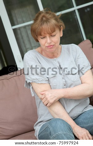 Senior woman with osteoarthritis pain - stock photo