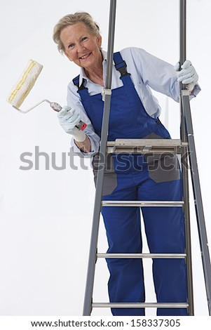Senior woman with painting cans - stock photo