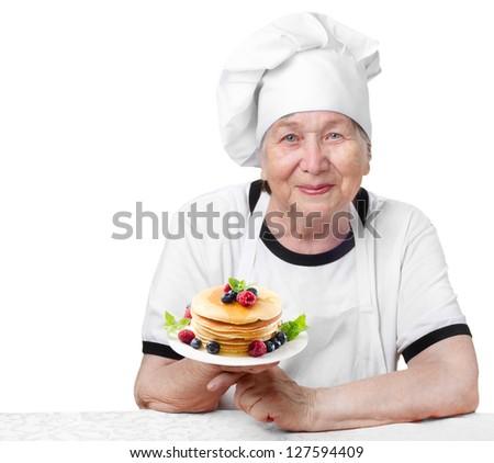 Senior woman  with pancakes isolated on white - stock photo