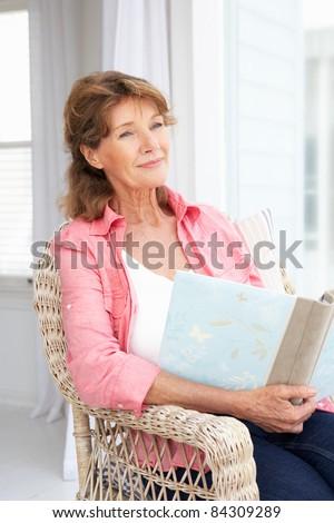 Senior woman with photo album - stock photo