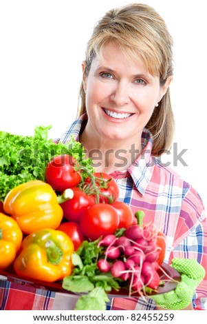 Senior woman with vegetables. Isolated over white background