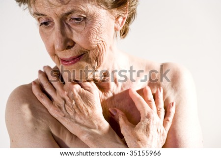 Senior woman with wrinkled skin - stock photo