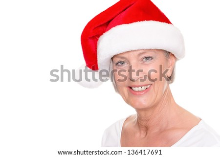 Senior woman with xmas cap in front of white background