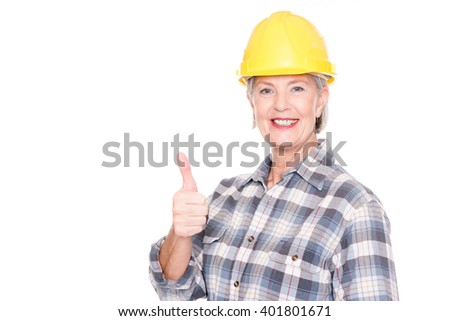 Senior woman with yellow helmet in front of white background - stock photo
