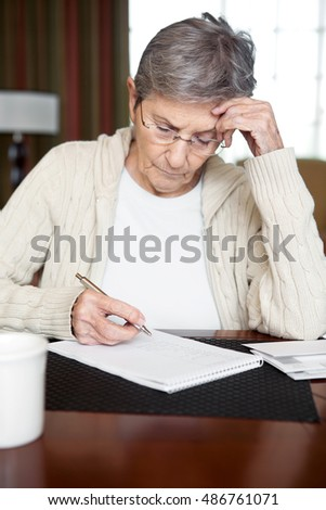 Senior woman working on a budget.