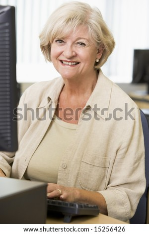 Senior woman working on a computer - stock photo