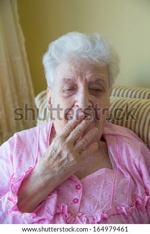 senior woman yawning