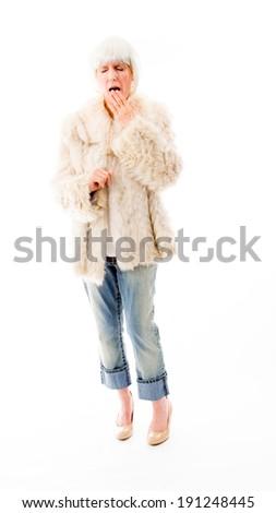 Senior woman yawning - stock photo