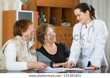 Senior women discussing health problems with therapeutist in clinic