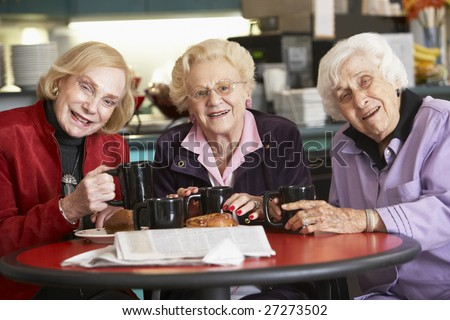 Senior women drinking tea together - stock photo