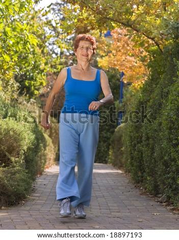 senior women exercise walking - stock photo