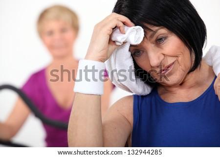 senior women in the gym - stock photo