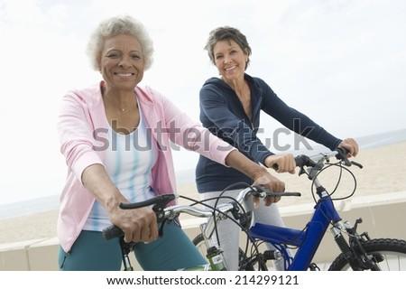 Senior women on cycle ride - stock photo